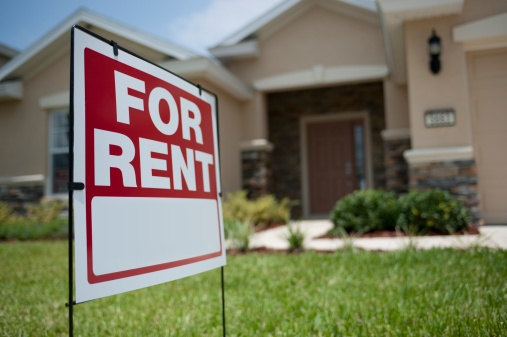 for rent sign in front of house - ThinkstockPhotos-149060607